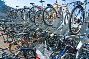 Many train stations in Switzerland provide double deck parking for bicycles.