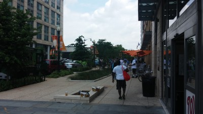 The NoMa neighborhood of Washington DC shows off with wide sidewalks that include shady seating and landscaping for stormwater management, a broad selection of restaurants and food trucks, a new Metro stop--and lots and lots of people.