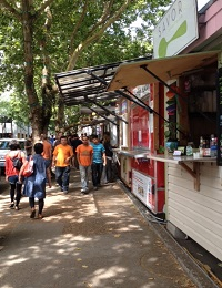 The city is scattered with food carts and there are block-long segments of permanent food vendors in cart-like structures.