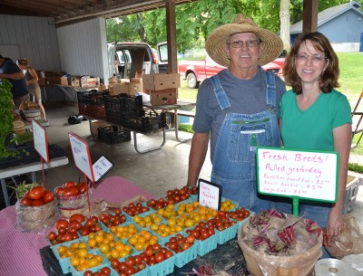 Farmers Joe and Mary Cooley enjoy talking with customers at the Mt. Pleasant Farmers Market on Island Park.