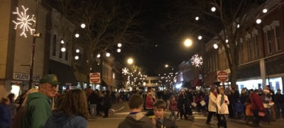 Holiday lights, decorations, and people fill downtown Allegan during the Christmas parade.