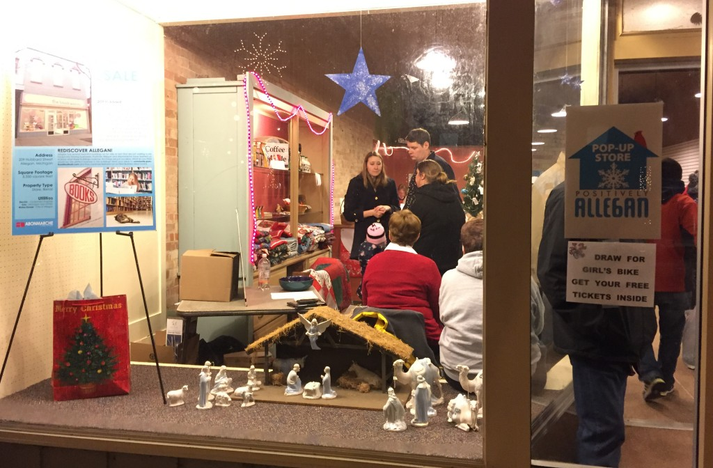 A formerly vacant storefront in downtown Allegan is filled with activity during Festive Fridays.