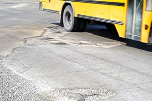 School-Bus-on-Bad-Roads-Potholes-small-for-web-300x199