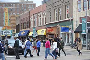 Downtown-Ann-Arbor-University-of-Michigan-on-Graduation-Day-May-2014-TownGown-(48)-300x200