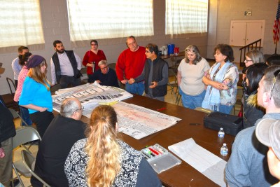 Designer Vinayak Bharne talks with Hazel Park residents about ways to improve their community as part of a CNU Legacy Project Tuesday.