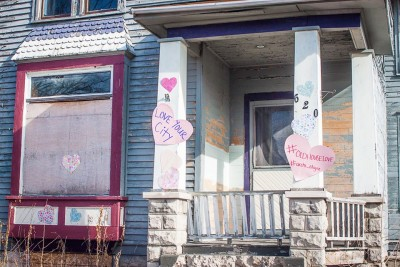 Posting valentines on vacant houses might not fix structural issues, but can help signal to a potential buyer that the community is pulling for them. (Photo courtesy Kristi Kozubel)