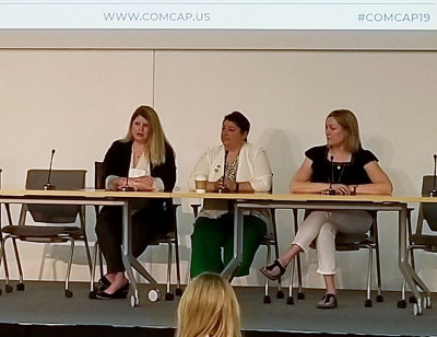 The League's Melissa Milton-Pung (left) speaks during a panel discussion today at ComCap in Detroit.